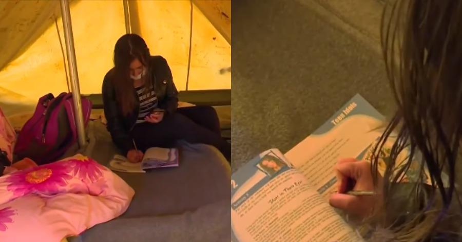 Τα συντρίμμια του σεισμού στην Ελασσόνα: Δεκαπεντάχρονη μαθήτρια κάνει τηλεκπαίδευση στη σκηνή.